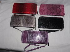 Clutch Purse With All Round Zip And Wrist Strap.