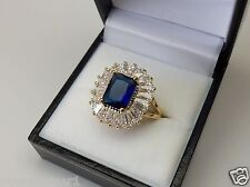 18ct Gold Plated Emerald Cut Blue CZ Cluster Ring.