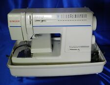 Singer Sewing Machine Model 9217, Includes Case and Attachments