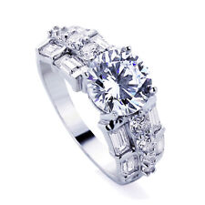 Sterling Silver Baguette Accented Round CZ Solitaire Engagement Ring
