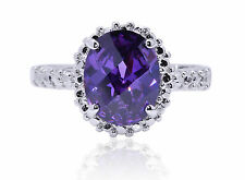 De Lelu Sterling Silver Simulated Amethyst Oval Cubic Zirconia Ring (2.54 cttw)