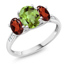 10K White Gold 2.33 Ct Oval Green Peridot Red Garnet 3-Stone Ring