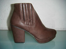 Ladies Brown High Heel Ankle Boots With A Platform Sole.  Sizes 3 - 8 Available