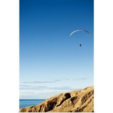 Poster Print Wall Art entitled On a bright blue sky a hang glider flies above