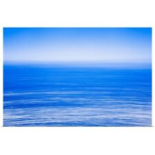 Poster Print Wall Art entitled Silky calm blue open sea with fog or mist over