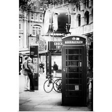 Poster Print Wall Art entitled Loving Couple Kissing and Red Telephone Booth,
