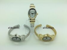 Ladies Small Oval Case Silver Gold Metal Bangle Cuff Easy Reader Watch EB6