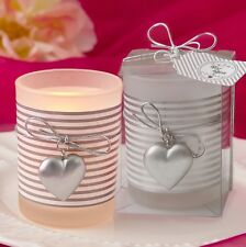 Glass Silver heart design votive candle holder with a white and silver striped d