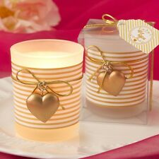 Glass gold heart design votive candle holder with a white and gold  striped desi