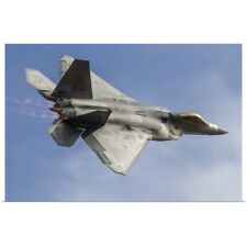 Poster Print Wall Art entitled A U.S. Air Force F-22 Raptor makes a fast flyby