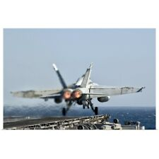 Poster Print Wall Art entitled A F/A-18F Super Hornet launches from the flight