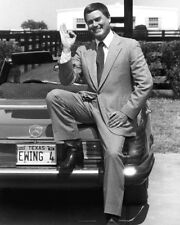 DALLAS: THE EARLY YEARS LARRY HAGMAN SITTING ON CAR GIVING OK SIGNAL PHOTO OR PO