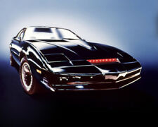 KNIGHT RIDER KIT CAR DISPLAYED WITH RED LIGHTS ON GLOWING BACKGROUND PHOTO OR PO