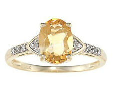 10k Yellow Gold Oval Citrine and Diamond Ring (1/10 TDW)