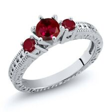 0.88 Ct Round Red Created Ruby Ruby 18K White Gold 3-Stone Ring
