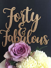 40th Birthday cake Topper reads: Forty & Fabulous
