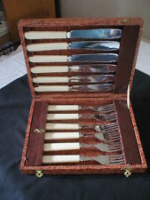 VINTAGE CHROME PLATE FISH KNIFE AND FORK SET IN ORIGINAL BOX.