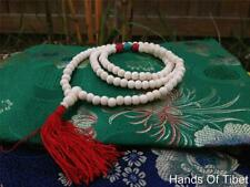 Yak bone mala with Turquoise and coral spacers