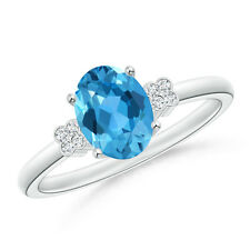 Natural Solitaire Oval Blue Topaz Ring with Diamond Floral Accent in 14k Gold