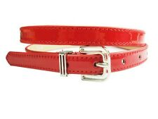 Fashion skinny patent leather belt w/silver square buckle and metal loop design.