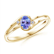 Split Shank Solitaire Oval Tanzanite and Diamond  Ring in 14K Yellow Gold