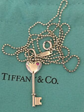 Tiffany & Co. Sterling Silver Heart Key Pendant Charm with Pink Sapphire