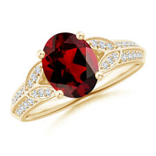 Oval Garnet Solitaire Ring with Pave Diamond 14K Yellow Gold