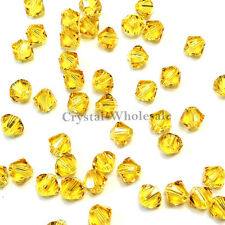 4mm Light Topaz (226) Genuine Swarovski crystal 5328 / 5301 Loose Bicone Beads