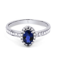 Natural 18ct White Gold Blue Sapphire and White Diamond Halo Engagement Ring