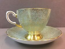 Footed Cup & Saucer by Tuscan Fine Bone China Gold Swirl Mint Green Background