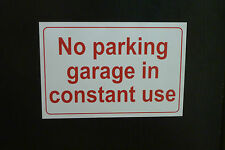 300x200 NO PARKING GARAGE IN CONSTANT USE sign plastic, sticker, HOLED house