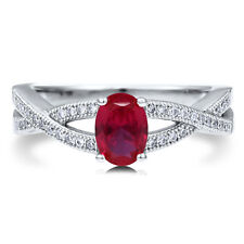 BERRICLE Sterling Silver Oval Simulated Ruby CZ Woven Solitaire Fashion Ring