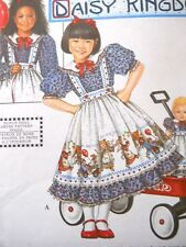 """Child's and Matching  18"""" Doll's Dress with Pinafores Simplicity 8552"""