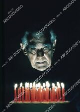 35m-14193 Boris Karloff blowing out his birthday cake candles 35m-14193