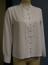 Embroidered Blouse with stand up colllar, pearl like buttons, embroidered cuffs.