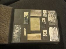 Vintage photo album people portraits and scenic views of buildings
