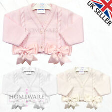 GIRLS BABY BOW CARDIGAN SPANISH STYLE BOLERO BOWS KNITTED AGES 0M TO 18M NEW