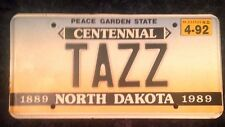 1992 NORTH DAKOTA VANITY PERSONALIZED LICENSE PLATE TAZZ TAZ TASMANIAN DEVIL TAS