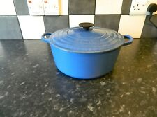 le creuset  cast iron casserole dish and lid in blue size 26