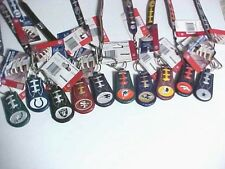 NFL KEYCHAIN AND BRACELET REAL FEEL OF A FOOTBALL,, YOU ARE BUYING ONE PAIR
