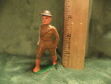 VINTAGE MANOIL BARCLAY LEAD SOLDIER MARCHING WITH SILVER SWORD SHOULDERED