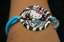 NEW HELLO KITTY BOTTLE CAP WITH NYLON BRACELET with Charm  -O/S YOUR CHOICE