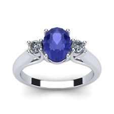 14K WHITE GOLD 3/4 CARAT OVAL SHAPE GENUINE TANZANITE AND TWO DIAMOND RING
