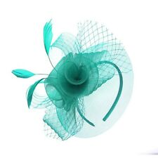 Turquoise Tripple Flower Centre Ladies Fascinator With Feather Detailing