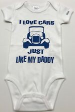 "Baby bodysuit, with large print ""I Love Cars Just Like My Daddy"" on front"