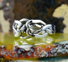 4 piece Sterling Silver Puzzle Ring in sizes 6, 7, 8