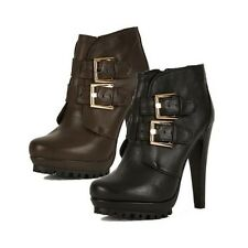 High heel ankle boots with buckle straps and platform sole