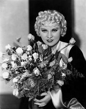 Mae West Holding Flowers in Black and White Dress High Quality Photo