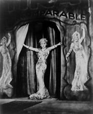 Mae West Performing in Floral Gown with Performers High Quality Photo