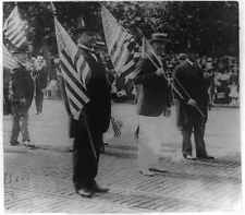Preparedness Parade,Woodrow Wilson carrying flag in parade,American flags,1916